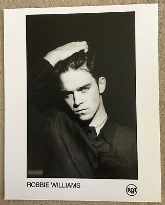 Robbie Williams Official Promotional Photo • 9£