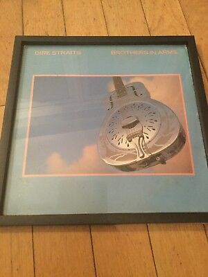 A Black Framed LP Cover Of Dire Straits Brother In Arms • 5£